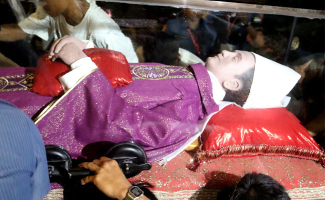 'Burial.' The coffin containing the late Archbishop Teofilo Camomot's remains and wax effigy was sealed and buried in a special tomb at the Domus Teofilo. (SunStar Foto/Alex Badayos)