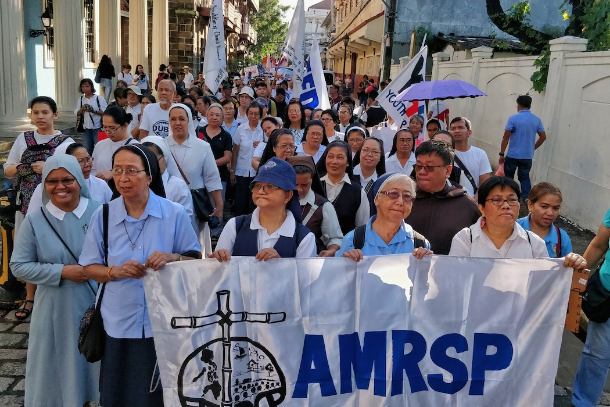 Religious priests and nuns join a protest march in Manila on Sept. 21. (Photo Vincent Go)