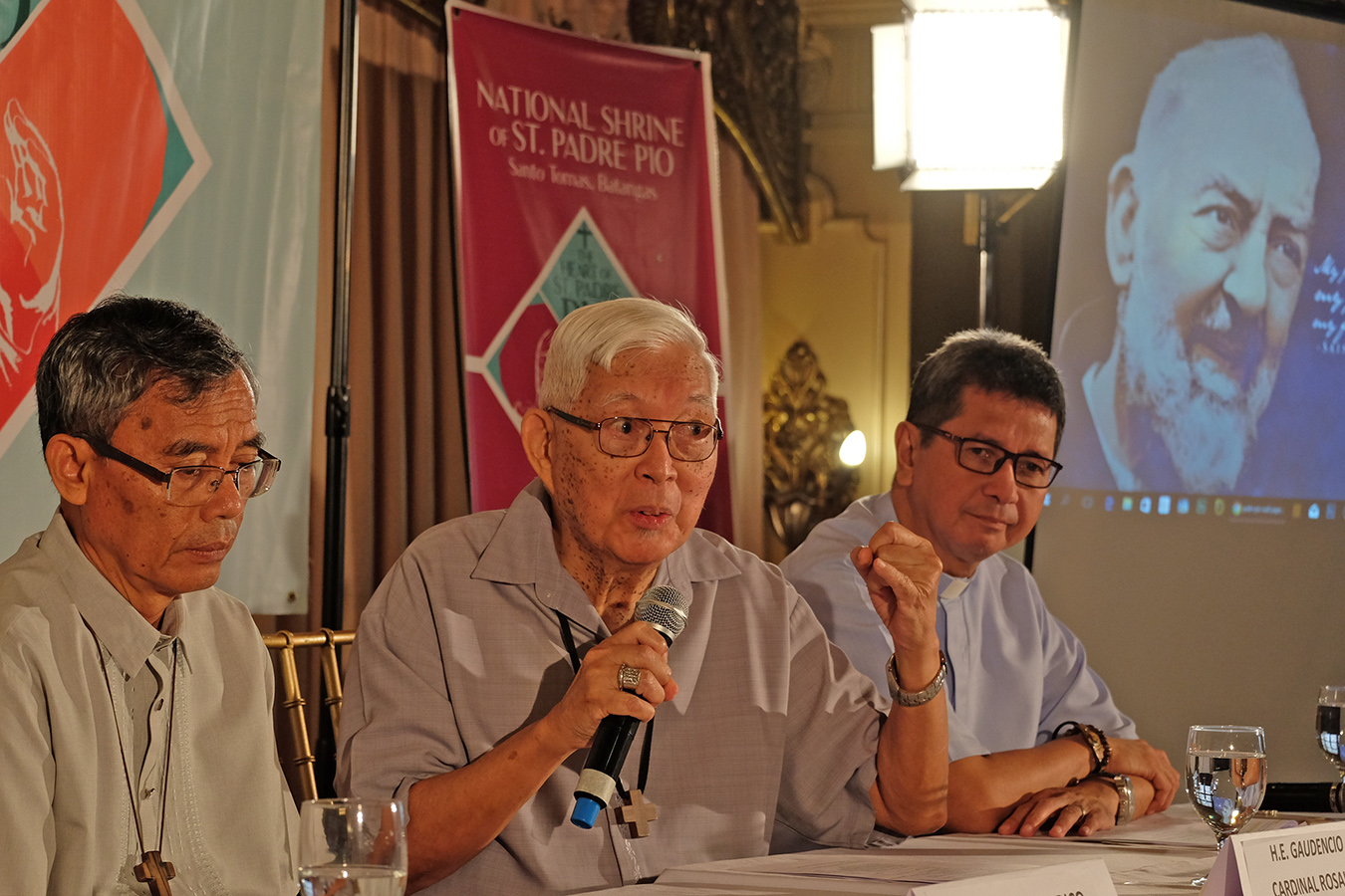 "Manila Archbishop Emeritus Gaudencio Cardinal Rosales is flanked by San Pablo Bishop Buenaventura Famadico and Fr. Joselin Gonda during a press conference about the upcoming visit of the ""incorrupt"" heart relic of Saint Padre Pio to the Philippines, Sept. 5, 2018. CBCPNEWS"